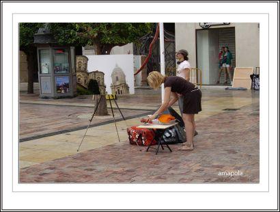 pintores en la plaza